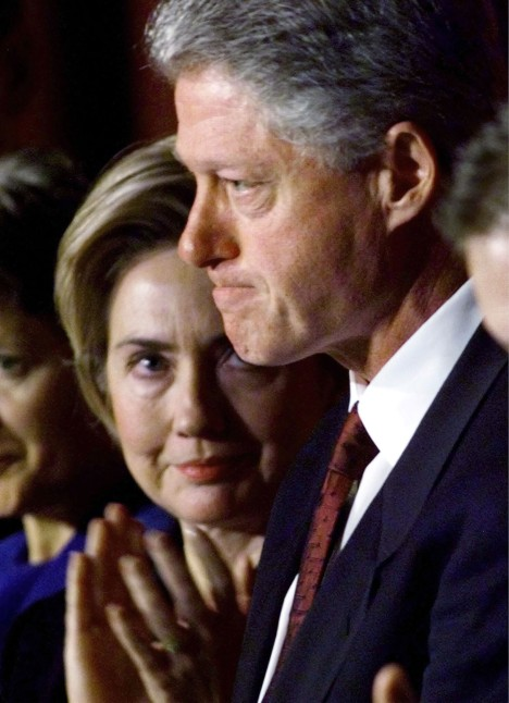 "Former U.S. first lady Hillary Clinton (L) looks at her husband, President Bill Clinton, immediately following his address to the National Prayer Breakfast in Washington DC in this February 4, 1999 file photo. U.S. Senator Hillary Clinton (D-NY) in her soon to be published book ""Living History,"" said that when Bill Clinton told her of the relationship with Monica Lewinsky, ""I could hardly breathe. Gulping for air, I started crying and yelling at him.""    REUTERS/Win McNamee/File"